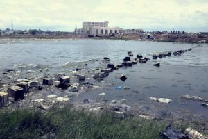 Old monitors used to build bridges over stream in Agbobloshie in Accra, Ghana